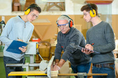 Male students in woodwork class. Male students in a woodwork class Stock Photos