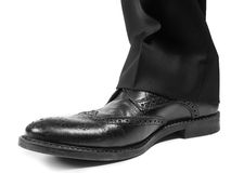 Male suit in black worn shoes. Closeup of male suit in black worn shoes towards white Stock Photo