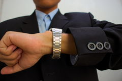 Male suit business staring wristwatch Stock Photo