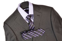 Male suit. Closeup of gray male suit with necktie over white Royalty Free Stock Photo