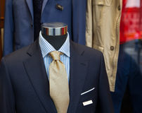 Male suit in the clothes shop. Close up of male suit exposed in the clothes shop Royalty Free Stock Images