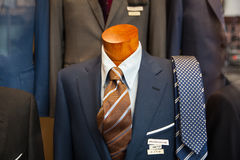 Male suit in the clothes shop. Close up of male suit exposed in the clothes shop Stock Photos