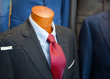 Male suit in the clothes shop. Close up of male suit exposed in the clothes shop Royalty Free Stock Photos