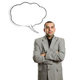 Male in suit with crossed hands and speech bubble. Looking on camera Royalty Free Stock Images
