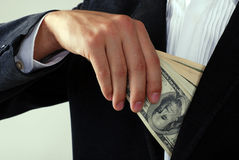 Male in suit with dollars in the hand Royalty Free Stock Photos
