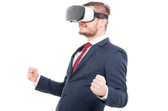 Male in suit with hi-tech reality glasses. On his head acting like a winner isolated on white Royalty Free Stock Photography