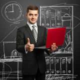 Male in suit with laptop in his hands Royalty Free Stock Photography