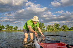 Male SUP paddler with paddleboard Royalty Free Stock Photo