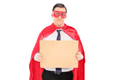 Male superhero holding blank carton sign Stock Image