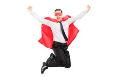Male superhero jumping out of happiness. Isolated on white background Royalty Free Stock Photo