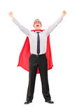 Male superhero raising his hands out of joy. Full length portrait of a male superhero raising his hands out of joy isolated on white background Stock Photo