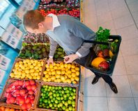 Male in Supermarket Buying Fruit Stock Photography
