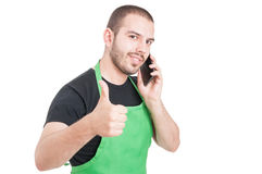 Male supermarket employee showing thumb up gesture. Isolated on white background with advertising area Royalty Free Stock Photography