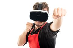 Male supermarket employer boxing wearing vr goggles Royalty Free Stock Photos