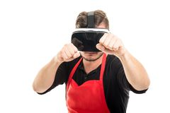 Male supermarket employer boxing wearing vr goggles Stock Photo