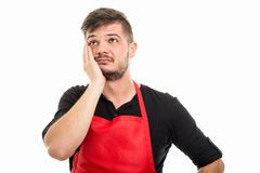 Male supermarket employer gesturing face palm. Like being worried isolated on white background with copyspace advertising area Stock Photos