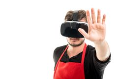 Male supermarket employer gesturing stop wearing vr goggles. Isolated on white background with copyspace advertising area Royalty Free Stock Image