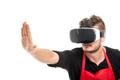 Male supermarket employer gesturing stop wearing vr goggles. Isolated on white background Stock Photography