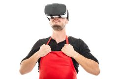Male supermarket employer gesturing superhero wearing vr goggles. Isolated on white background Stock Images