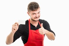 Male supermarket employer holding business card showing like Royalty Free Stock Images