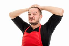 Male supermarket employer holding head like stretching Royalty Free Stock Photos