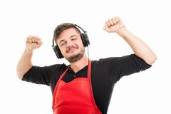 Male supermarket employer looking happy listening to headphones. Isolated on white background Royalty Free Stock Image