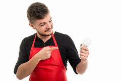 Male supermarket employer pointing light bulb. And smiling gesture isolated on white background Royalty Free Stock Photography