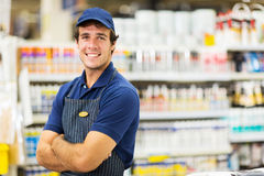Male supermarket worker. Portrait of male supermarket worker with arms crossed Stock Photo