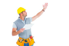 Male supervisor with hand raised holding clipboard. On white background Stock Image