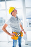 Male supervisor inspecting building. Male supervisor with clipboard inspecting building Stock Image