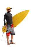 Male surfer holding a surfboard. Full length portrait of a male surfer holding a surfboard isolated on white background Stock Photos