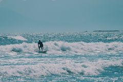 Male surfer in the ocean,summer background concept royalty free stock image