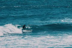 Male surfer in the ocean,summer background concept royalty free stock photography