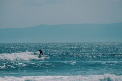 Male surfer in the ocean,summer background concept royalty free stock photo
