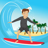 Male surfer riding large blue ocean wave near the tropical island with palm trees. Male surfer riding large blue ocean wave near tropical island with palm trees Stock Photography