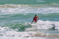 Male surfer surfing at Miami beach Stock Image