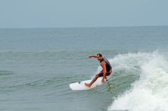 Male Surfer Surfing Wrightsville Beach, NC Royalty Free Stock Photo