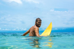 Male surfer waiting for the wave. In water Stock Photo