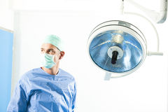 Male Surgeon. Portrait of a male surgeon inside operating room Royalty Free Stock Photography