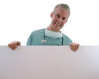 Male Surgeon (add your text). Male Surgeon with blank sign (add your own text to the sign Royalty Free Stock Image