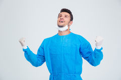 Male surgeon celebrating his success. Portrait of a male surgeon celebrating his success isolated on a white background Royalty Free Stock Image