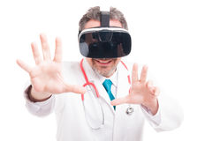 Male surgeon enjoy experiencing virtual reality. And doing a catch gesture isolated on white Stock Photography