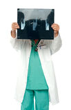 Male surgeon hiding his face with x-ray report Royalty Free Stock Photo