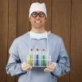 Male surgeon holding test tubes. Stock Photos