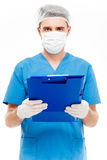 Male surgeon in mask holding clipboard. Isolated on a white background Royalty Free Stock Photo
