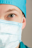 Male surgeon in mask looking at camera on grey background, close up Royalty Free Stock Photography