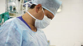 Male surgeon in operation room stock video