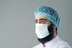 Male surgeon posing against a grey background.  Stock Photography