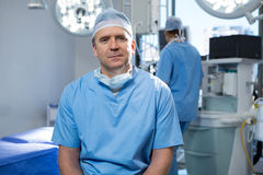 Male surgeon sitting in operation theater. Portrait of male surgeon sitting in operation theater Royalty Free Stock Photos