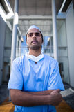 Male surgeon standing with arms crossed. In hospital corridor Royalty Free Stock Photos
